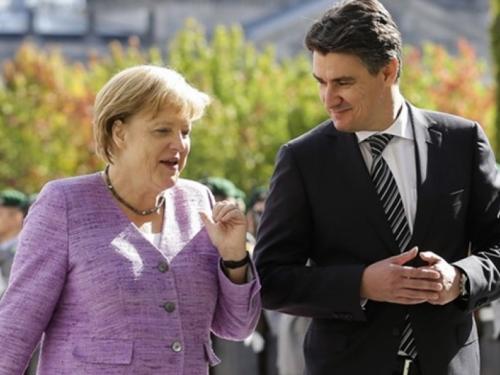 Merkel: Hrvati, zadržite izbjeglice neko vrijeme kod sebe; Milanović: Ne!