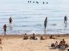 Turisti u šoku: 83 migranta se usred dana iskrcala na punu plažu